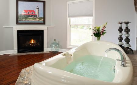 In-room jacuzzi next to gas fireplace