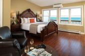 King bed with views of Lake Huron