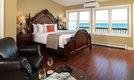 King bed with views of Lake Huron